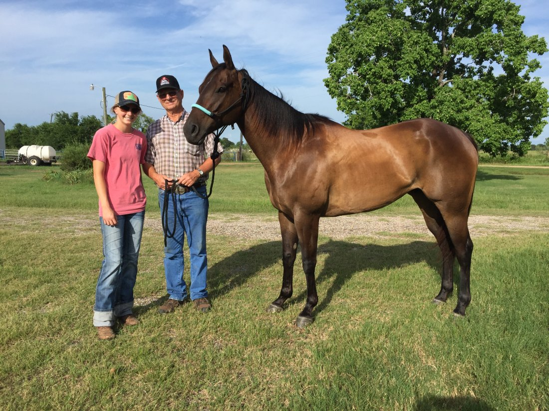 Jordan Ellery and Ronnie Woodley With Tommy at his new home in Williis, TX